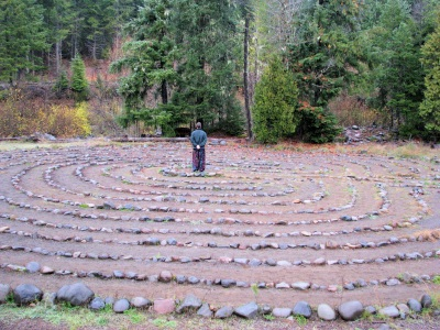 Brent VanFossen stands in the middle of the Breightonbush Hot Springs Labyrinth - photography by Lorelle VanFossen.