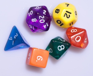 Collection of multi-sided, colorful dice.