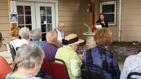 Lend an Ear 2015 - Audience listens to Marilyn Schmidlin read - photography by Lorelle VanFossen.