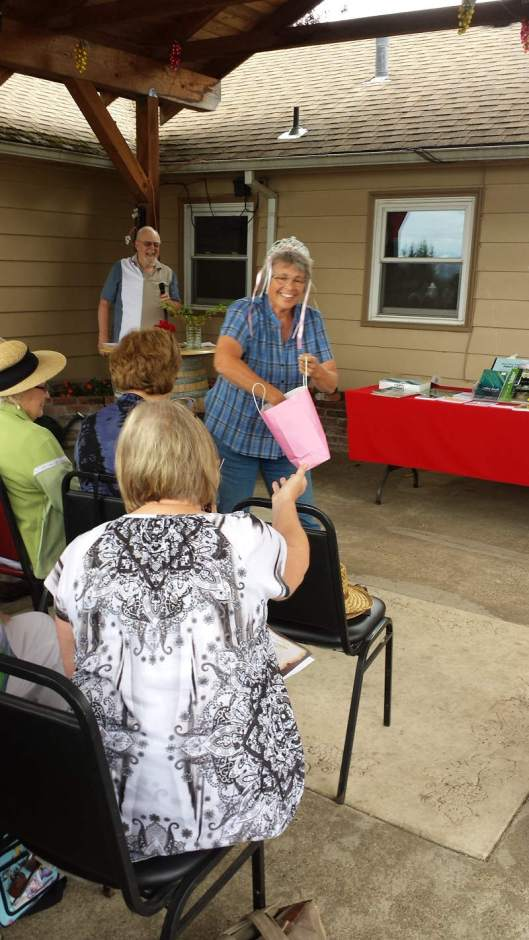 Lend an Ear 2015 - Susan Schmidlin distributes goodies after her reading to the audience.