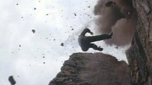 Cliffhanger movie 1993 screencap of man falling from landslide on cliff
